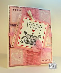"""""""You're Just My Type"""" card made with:    - Gina K. Designs """"True Love"""" stamp set  - Gina K. Designs designer paper from the True Love StampTV kit  - Gina K. Designs Pure Luxury 120 lb base weight card stock  - Gina K. Designs Pure Luxury 80 lb layering weight card stock  - Gina K Designs Innocent Pink and Bubblegum Pink card stock  - Copic markers  - Stampendous white embossing powder  - Pink glitter paper  - Various ribbons  - Red thread  - White mini clothes pin  - Pin gems"""