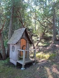 cute outhouse with balcony