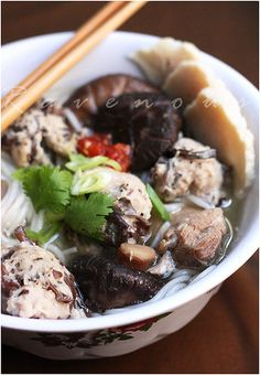 Bun Moc • Pork and Mushroom Noodle Soup • Vietnamese food • A vermicelli noodle soup made from a pork and shiitake mushroom infused broth, served with Gio Song (pork paste balls) and Cha Lua (pork sausage).