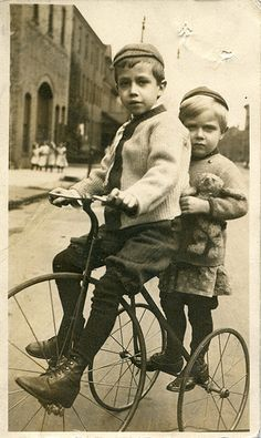 Two boys on a tricycle, 1904-18