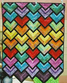 """Clever use of strips: Tibetan Prayer Flag quilt, 43 x 55"""", pieced by Roberta Balogh, quilted by Delinda Eaton.  Ohio Mennonite auction."""
