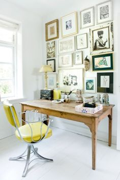 simple desk with lots of frames