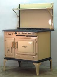 Antique wood and electric cook stove.