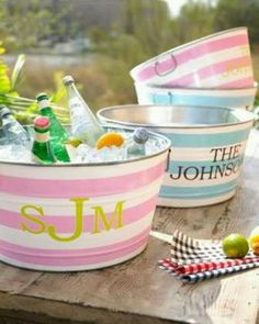DIY:: (no tutorial) I Simply Use Spray Paint + Stencils on steel buckets (I got both my Large Buckets for 4 dollars new from a craft store using a 50% off coupons!! ) to Create Adorable Spring- Summer Bucket To Chill Your Favorite Beverages!