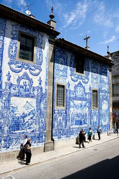 beautiful street art on building in azulejos - porto, portugal