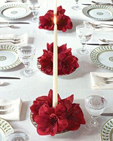 A bold choice — table setting with amaryllis floral candle holders.