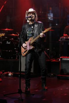 """GRAMMY winner Brad Paisley kicks it up a notch during a performance on """"Late Night With Seth Meyers"""" on Feb. 26 in New York"""