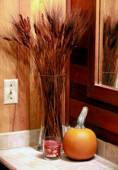 Bring fall into your home with some Autumn accents. We love the idea of bringing color into the home with natural elements like this pumpkin.