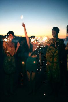 Sparklers on a summer sunset evening. FOLLOW http://www.pinterest.com/happygolicky/summer-style-jewelry-clothing-swimsuits-accessorie/ for all things summer #beach