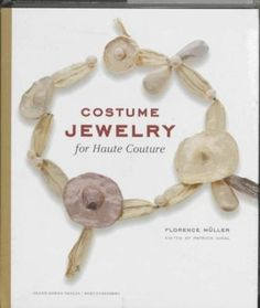 """Costume Jewelry for Haute Couture by Florence Muller / Expertly co-authored by fashion historian and consultant Florence Muller and haute couture costume jewelry collector Patrick Sigal, """"Costume Jewelry For Haute Couture"""" is a profusely illustrated compendium showcasing dazzling, one-of-a-kind jewelry designed by skilled artisans to complement and adorn individual couture pieces for fashion shows and photo shoots."""