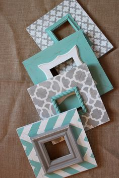 LOVE LOVE LOVE these! Super easy, too! Get old/cheap pictures frames (these are wooden ones), paint if you'd like, & layer them! Definitely genius to pull together different colors in a room.