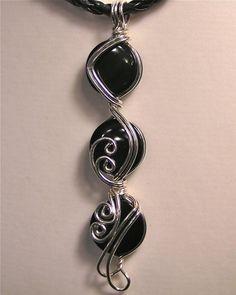 Black Onyx ... Swirls in Sterling Silver Wire Pendant