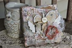 """Shabby Chic 4x4 Canvas - """"Creative Scraps"""" by Peggy Lee: Gypsies Moments """"Heart with Wings"""" Art Canvas  This hurt with wings canvas was created with Glimmer Mist and Gesso to create a weathered look.  Petaloo flowers love Glimmer Mist..visit Peggy Lee's blog for all the fun details #4x4challenge #canvascorpbrandscrew #tatteredangels #7gypsies"""