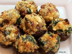 These Stuffed Mushrooms have a hearty meaty, deeply savory taste but are vegetarian.  Use Baby Bellas for finger food or Large Portobellos for an entree. #stuffed #mushrooms
