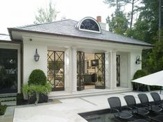 stucco or lime washed  brick w/ steel doors, I DONT WANT WHITE, needs to blend into natural surroundings more!! Harrison Design Associates Projects