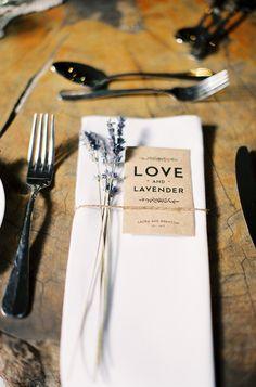 lavender seed favors + sprigs of lavender tied around napkin. pretty!
