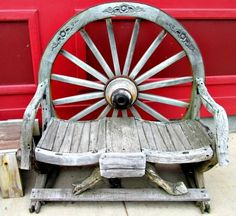 Outdoor Wagon Wheel Swing Glider The American West
