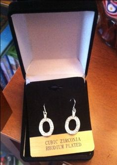Cubic Zirconia, Rhodium Plated Earrings.  Retail $50.  Brand new.  SELL PRICE: $20.