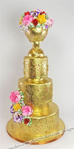 Gold wedding cake by Design Cakes, via Flickr
