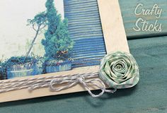 Add paper flowers and Baker's Twine to your popscicle stick picture frames for a trendy twist on this timeless craft idea. http://www.craftysticks.com/Popsicle-Stick-Craft-Photo-Inspiration_b_8.html