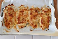 OMG Chicken - Simply mix 1/2 cup of sour cream and 1/4 cup of parmesan cheese. Spread over chicken breast in a baking dish. Sprinkle Italian bread crumbs on top. Bake at 350 degrees for 25 minutes.