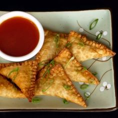 Crispy, crab and cream cheese stuffed wontons with a homemade sweet and sour sauce. An easy last minute holiday hors d'oeuvre.