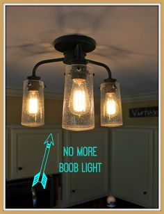 """Karin of the blog """"Art is Beauty"""" replaced her flush-mount """"boob light"""" with a Kichler Braelyn light fixture. Check out the before and after here: http://arttisbeauty.blogspot.com/2014/12/vintage-style-kitchen-lighting-update.html"""