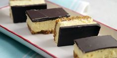 Nanaimo Cheesecake Bars 2 ½ cups graham crumbs ½ cup butter, melted ...