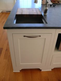 Cutting board opening to trash can....would love this!