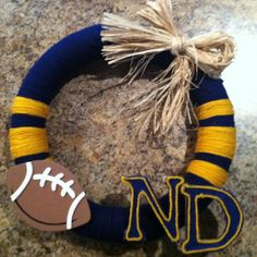 Notre Dame football wreath by RustiqueGoods on Etsy, $25.00.....but NCSU of course