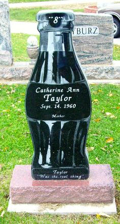 """Catherine Taylor, """"Taylor was the Real Thing"""" Coke Bottle Headstone."""