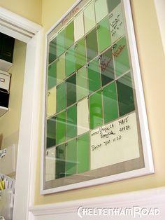 Paint chips + poster frame = dry erase calendar.