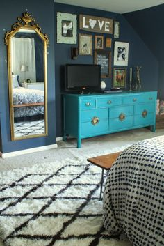 Primitive & Proper: Master Bedroom Updates:gallery wall around tv, moroccan rug, turquoise asian rug