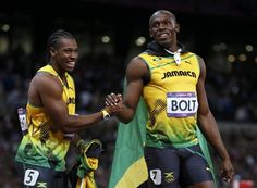 Jamaica's Usain Bolt (R) shakes hands with team mate and second-placed Yohan Blake after winning the men's 100m final during the London 2012 Olympic Games at the Olympic Stadium August 5, 2012. Bolt proved that lightning can strike twice by retaining the 100 metres sprint title, the most coveted of all Olympic golds, in a searing 9.63 seconds - the second fastest run of all time.