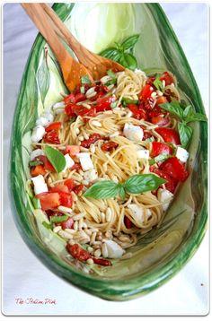 Two tomato pasta with mozzarella, basil and pine nuts. Yum!