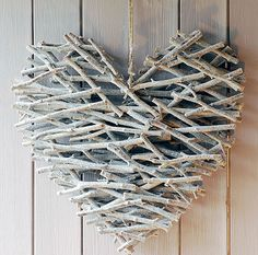 Heart (sticks, hot glue, & spray paint)  (I can see this in natural colors, all kinds of shapes, for great rustic cabin decor, maybe incorporating other things - like a bird for a birdhouse shape, etc - can also see it as it is here with a bright red bow or poinsettia blossom or cardinal, or a bit of greenery or holly with berries, for Christmas decoration ~TA)