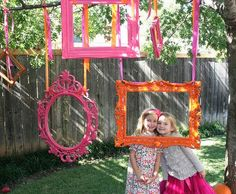 Hanging decorative picture frames (school colors) for pictures at graduation party