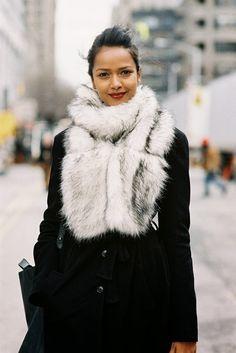 Bundle up in fur scarf and black coat... via: Vanessa Jackman