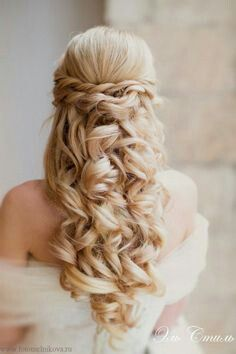 I like the combo of the braids and curls :) Would be really pretty with a veil!