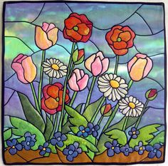Happy It's Spring by Allie Aller (Washington). Stained glass quilt, machine appliqued.
