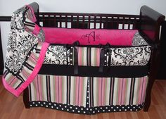 Kate Baby Bedding  This is a modern custom 3 pc crib bedding set.   It includes a black and white damask, polka dot, stripe, and soft hot pink minky bumper.  The coordinating blanket features a cuddly soft minky backing and edge. The crib skirt is a tailored box pleat with a polka dot pleat and border