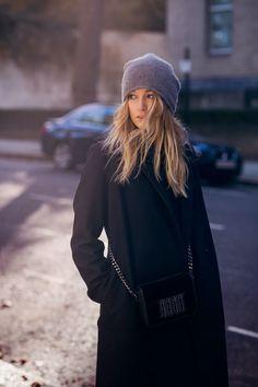 Black coat, gray knit hat