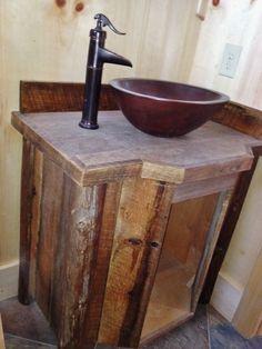 Handmade bathroom vanity crafted from reclaimed barn wood