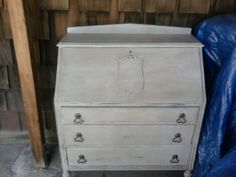 Secretary desk upcycled in ASCP  Paris Grey, distressed, added dark wax; the inside painted in aqua blue ASCP Provence.