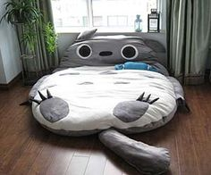 Take a little cap nap with this Totoro cat bed that also functions as a sleeping bag. Inspired by the My Neighbor Totoro Japanese anime film, this over-sized...