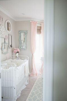 Shabby Chic Nursery Ideas - love the floating frame gallery wall and muted color palette. Nursery perfection!