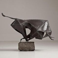 A Brutalist Metal Sculpture of a Charging Bull mid 1960s
