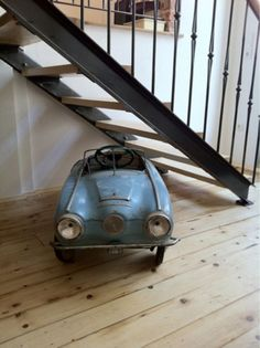 Little blue pedal car