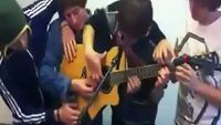 Four Guys, One Guitar - Funny Videos at Videobash