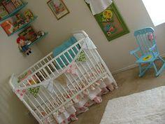 Darling vintage nursery with Jenny Lind crib, baby girl.